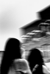 Building and Girls (draketoulouse) Tags: chicago chinatown people street streetphotography blackandwhite monochrome blur abstract shake city urban perspective