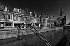 Bolsward / Friesland (zilverbat.) Tags: friesland bolsward holland centrum blackwhitephotos blackandwhite winkelstraat buildings architecture sunny thenetherlands town city visit citytrip cityscape church tripadvisor travel blackwhite zwartwit bw zwartwitfotografie monochrome noir blanco negro hanzestad cultuurstad sportstad elfstedenstad 1615 stadhuis cultuur racefiets fietsroute route map wandelroute gevelrij oud history