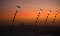 BaCK. (Warmoezenier) Tags: clouds lantaarnpaal nederland orange oranje vlissingen vrachtschip zeeland zonsondergang