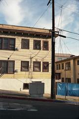 (ADMurr) Tags: la leica m4 35mm summaron kodak ektar film yellow apartments pole stop