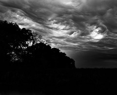 Sky dances (momrunninglate) Tags: storms storm stormy clouds trees rural landscape weather spring