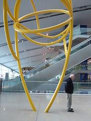 Waiting all alone (seikinsou) Tags: spring kenyatour udp urbandevelopmentprogramme ireland dublin airport sculpture terminal2 arrival yellow