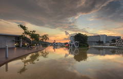 Wading Pool Sunset (henriksundholm.com) Tags: vivocity harbourfront sentosa sunset sunsets clouds cloudy sky landscape reflections pond wading boardwalk roof rooftop advertisement mall shopping singapore southeast asia hdr nikon travel colors harbourfrontcentre