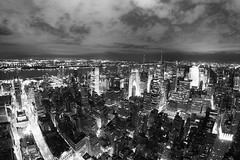 New York city (roust  evin) Tags: new york city nyc light bw white ny newyork black building night landscape us manhattan united states