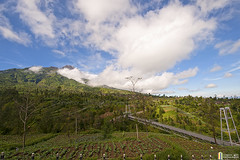 Bridge To Mount Merapi (shahreen | amri) Tags: morning travel blue red vacation sky cloud mountain lake black tree green tourism nature beautiful beauty yellow rock fog stone clouds danger forest sunrise indonesia landscape outdoors fire volcano java high asia view natural bright path smoke south hill north scenic culture peak scene gas tropical ash volcanic merapi active
