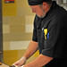 A cook slices up pizza at Fahrenheit at On The Oval, University Dining's newest hot spot for meals on Centennial Campus.
