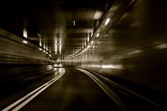 Tunneling Through The Lincoln (jomak14) Tags: newyorkcity blackandwhite bw monochrome lumix panasonic explore motionblur g2 lincolntunnel hss pancakelens lumix14mmf25 nativem43lens drivingthroughthestreets