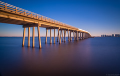 Navarre Bridge Long Exposure (Stuart Schaefer Photography) Tags: longexposure seascape bridges navarre floridatravel navarrebridge vision:sunset=0586 vision:outdoor=0954 vision:sky=0822