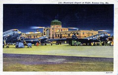 Municipal Airport at Night Kansas City MO (Edge and corner wear) Tags: vintage postcard pc airport night bright lights tonight runway tarmac prop planes missouri kansas city dc3 airplane propeller control tower aviation passenger progress progressive midwestern midwest