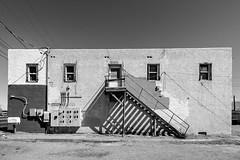 (el zopilote) Tags: albuquerque newmexico cityscape street architecture powerlines signs us66 canon eos7d canonefs1018mmf4556isstm bw bn nb blancoynegro blackwhite noiretblanc digitalbw bndigital schwarzweiss monochrome