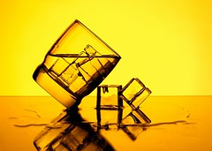 Ice Cubes (Karen_Chappell) Tags: ice orange yellow glass tilt icecubes square water drink alcohol booze stilllife reflection