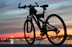 A sunset, a bike and a 50mm... (Michael Kalognomos) Tags: bike bicycle sunset greece lights sky canoneos70d ef50mmf18 bokeh dof depthoffield sea landscape streetphotography