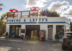 Poncho & Lefty's (trainmann1) Tags: nikon nikkor amateur handheld westvirginia wv september summer 2016 d90 ponchoandleftys building garage rebuilt rehabilitated restaurant blue bluesky white sunrays sunflares bright fishtaco tacos tables umbrellas food