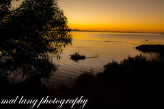 Going Fishing at sunrise (Malcom Lang) Tags: fishing boat rods motor sea ocean rocks trees treeline calm water southaustralia southern south southernaustralia southerneyrepeninsula southernocean eyrepeninsula eyre lowereyrepenninsula australia australian aussie earlymorning sunrise vessel view bay boston port lincoln island silhouette sighn sky weather mal lang photography canoneos6d canon canonef2470mm canon6d canonef ag ngc anotherhotday heat summer bouy leaves branches