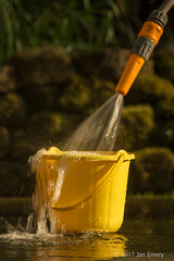 Yellow Bucket (Jamarem) Tags: april 2017 yellow bucket hose pipe water garden easter spill ndstopper