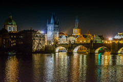 Bohemian Nights (Abhirup.D) Tags: nights lights water spire river castle europe bridge architecture reflection religion springtime