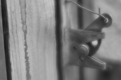Everything Out Back Was Secure (MPnormaleye) Tags: latch lock gate fench wood macro lensbaby velvet56 prime rural monochrome blackwhite soft bokeh