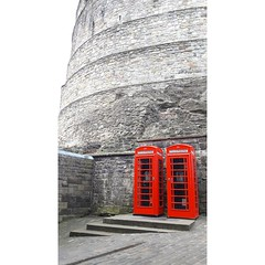 the fortress and its phones (borisvasilev) Tags: edinburgh scotland castle phone booth red digitalphotography travel contrast fortress old grey