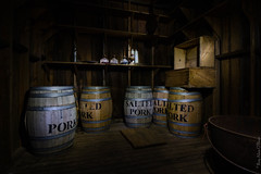 Larder (royophoto) Tags: nightphotography fortgriffin lightpainting messhall barrels oillamps crates kettle wood woodenfloor