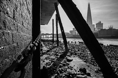 70/365 - How low can you go? (Spannarama) Tags: 365 march blackandwhite shard supports struts beams chain foreshore riverbed architecture buildings framed cannonstreetrailbridge bridge river thames londonbridge buses southwarkcathedral london uk samyang12mm