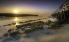 Harbour channel sunset (rudi.verschoren) Tags: rood sunset water dawn evening landscape seashore beach sea noordzee light lines nature ocean scenic reflection sky sun travel dusk fair weather belgium coast outdoor panoramic sand rocks pier flanders europa europe canon eos 70d