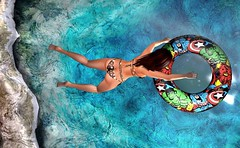yippie .. here I come .. (Larah Sa'fir) Tags: jump floater water sexy girl bikini