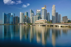 Singapore city and building in day time with water flont and refleaction (anekphoto) Tags: singapore skyline city day urban business bridge water marina bay district cityscape outdoor architecture building asian center exterior downtown landscape reflection panorama blue esplanade white bright light view skyscraper asia high financial landmark town panoramic tower famous commercial tall waterfront riverside modern beautiful design nature color sky natural colorful nobody