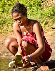 Cleaning, Madagascar (Rod Waddington) Tags: africa afrique madagascar malagasy woman outdoor cleaning water river native portrait people candid shoes