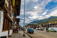 Paro City, Bhutan (Mijan Rashid) Tags: paro bhutan cars car vahicle asia asian canon canon1100d canon1100 1100d 18270mm streetphotography street photography travelphotography sky blue bluesky clouds cloud cloudy cloudyday house hills himalayas himalaya shops people road