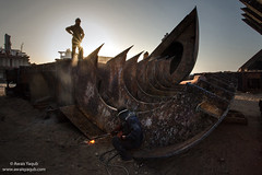 The Monster Ship (Awais Yaqub) Tags: gadanishipbreakingyard gadani pakistan labour sunset endofday heavymachinery ships sunstar