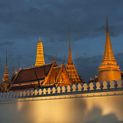 Grand Palace at dusk (Andrew Tan 2011) Tags: lighting wall architecture thailand golden warm king dusk bangkok stupa royal spire grandpalace bluehour monarchy mixedlighting bhumibol adulyadej