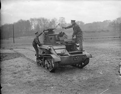 The crew of a Light Tank Mk VI climb into their vehicle, Aldershot, 1939.