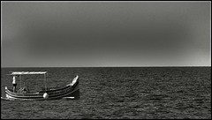 "One man in a boat (Explored) (CJS*64 ""Man with a camera"") Tags: bw mono blackwhite malta panasonic explore craig cjs sunter explored fz45 panasonicfz45 craigsunter click64 cjs64"