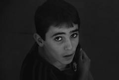 Melhem (Faisal Aljuhani) Tags: street boy bw face kids eyes faces arabia 2013 melhem