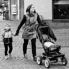 Motherhood (R A Pyke (SweRon)) Tags: street boy blackandwhite bw woman walking focus child sweden stroller cobbled fujifilm manual pram rebro drottninggatan xpro1 sweron olympusomzuiko50mmf14 20130927174