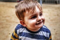 Tantarantana (Jokin BCN) Tags: barcelona boy portrait baby smile playground happy kid sand uploaded:by=flickrmobile flickriosapp:filter=nofilter