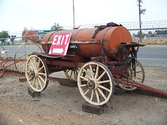 1800's  Fuel Wagon or maybe a water wagon ? (Bob the Real Deal) Tags: sign wagon fresno exit kodakz712iszoom simonianfarms fuelwagon 1800swagon