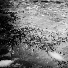 Aerial II (The Paul Miller) Tags: shadow summer sky cloud white black mountains west blanco lines zeiss plane grid photography nikon desert y earth negro dry aerial american round fields crops isolation network roads 5100 elevation desolate irrigation valleys