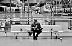Sitting In A Railway Station [Explored #335] (jaykay72) Tags: street uk blackandwhite bw london candid streetphotography londonist stpancrasstation stphotographia potd:country=gb