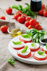 Italian traditional salad caprese (Oxana Denezhkina) Tags: red food white green closeup cheese dinner tomato cuisine restaurant leaf salad healthy italian view dish eating top background traditional plate vegetable fresh gourmet meal vegetarian oil basil appetizer diet mozzarella nutrition caprese vision:food=0609 vision:outdoor=0785