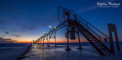Grand Haven Pier (Kevin Povenz) Tags: blue winter sunset lighthouse cold ice beach lights evening pier dusk michigan february grandhaven 2014 westmichigan kevinpovenz