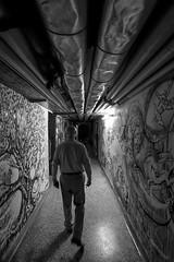 Jailer (CoolMcFlash) Tags: man person bw bnw blackandwhite blackwhite gangway underground creepy fear graffiti jailer tubes cellar spooky atmosphere canon eos 60d mann sw schwarzweis gang angst unheimlich rohre kellar narrow eng stimmung fotografie photography dark dunkel sigma 1020mm 35 wall wand mauer