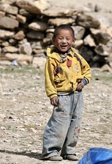 Big Smile! Tibetan Boy Far Western Nepal Asia (eriagn) Tags: beads amulet boy happy smile yellow blue red mountain peak snow trail track people yak horses asia nepal landscape highaltitude remote isolated rugged traderoute salttrade ricetrade tibet traditional ancienttraderoute tibetan farwesternnepal trading salttrain sheep goat saddlebags woven trek trekking walking himalaya vegetation eriagn ngairehart ngairelawson travel expedition nepalese mountainous rocky narrow historical elevation documentary dailylife photography kanaliriver river karnaligorge textile salt rice wool naralagnapass arid steep naturesabstract exploreunexplored