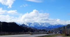 The Cascade Mountain Range (starmist1) Tags: mountains snow cascademountains mountainrange freeway autos cars bridge sky clouds forest trees foothills orchards
