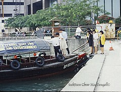 Getting on a water taxi (Welcome fellow photographers) Tags: watertaxi singaporeriver passengers transportation bumboat singaspore