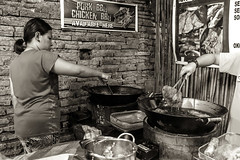 Into the Hot Oil _8409 (hkoons) Tags: cityofvigan ilocossur maritimesoutheastasia new7wonderscities potsandpans southeastasia unescoworldheritagesite cookingfire marketplace hispanic philippines vigan carbohydrates cook cooking diner eats fire fish fodder food fruit fruits groceries island islands kitchen lunch market meats preparations proteins public room sales salesmen saleswomen stall stand starch sugars tropical tropics vegetables vendor vendors