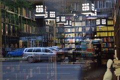 The street through and beyond the windows 2 / Tuesdays: Crazy Windows (fdlscrmn) Tags: window book lights street 7dwf reflection traffic cars bucharest