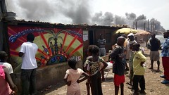 Rising (Spen Crush Proof) Tags: spen cp crushproof sierra leone kingtom freetown graffiti children art watching smoke people home shashamani palmtree sun united