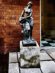 The Statue of the Maiden (Steve Taylor (Photography)) Tags: maiden plinth courtyard tiles vase art digital sculpture statue wall black brown blue grey concrete tile lady woman newzealand nz southisland canterbury christchurch city texture