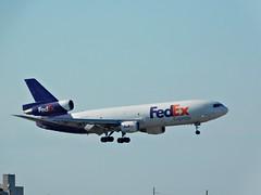 FedEx Express McDonnell Douglas DC-10-10F Landing at the Miami International Airport (Comiccreator24) Tags: mia kmia miamidade miamidadecounty miamiinternationalairport aviation avgeek dc10 dc10f mcdonnelldouglasdc10 trijet triholder fedex federalexpress fedexexpress